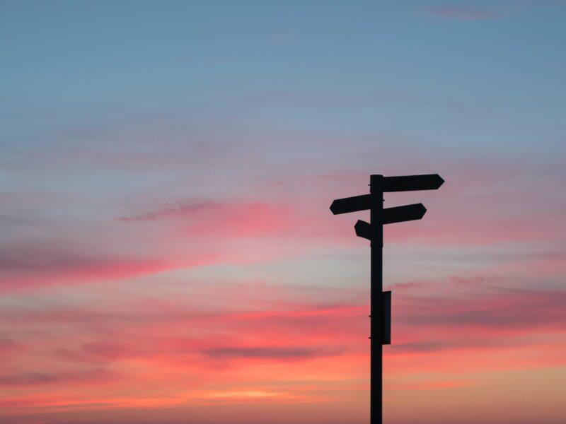signpost at sunrise