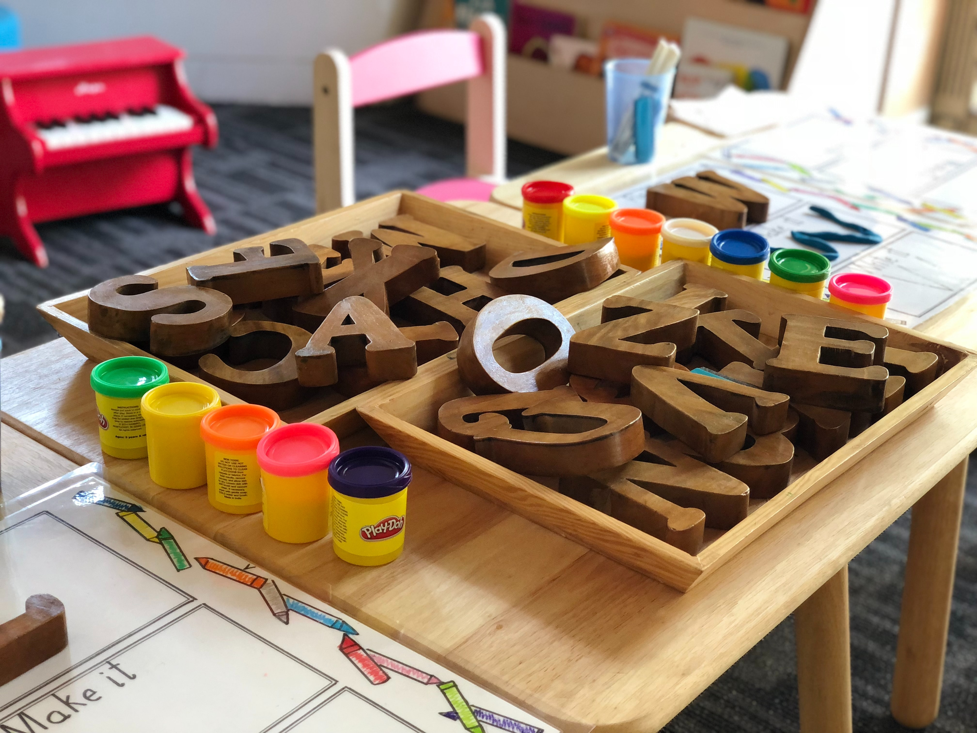 classroom with letters and playdough